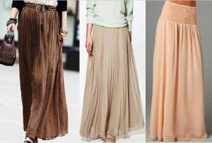 Длинная бежевая юбка является частью базового гардероба
