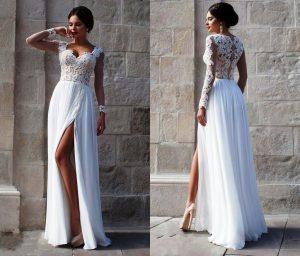 Белое платье с кружевом в сочетании с дорогими украшениями создает поистине королевский образ