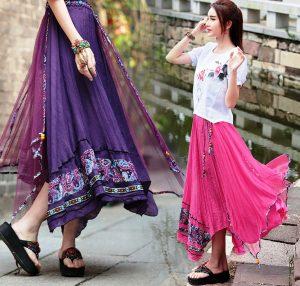 Длинная асимметричная юбка в восточном стиле содержит сложные драпировки и элементы декора