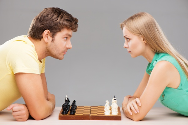 serious-couple-starting-chess-game