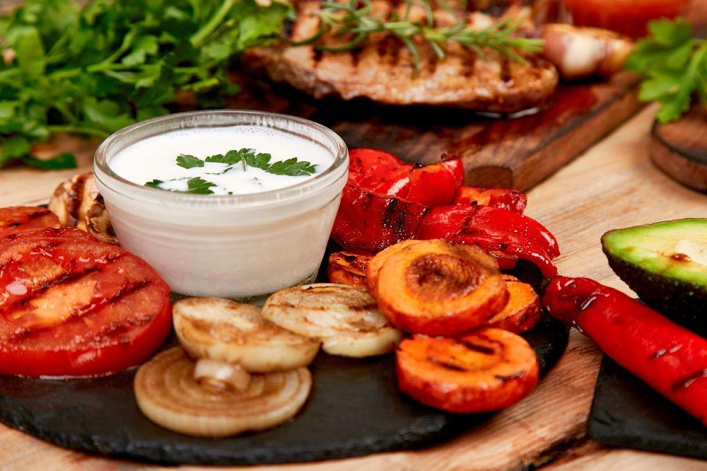 grilled-vegetables-on-black-background-diet-vegan-food