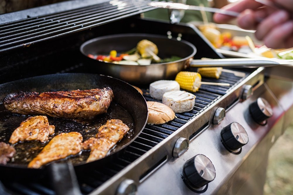 meat-and-sausages-on-the-grill-garden-party-outside-in-the-backyard