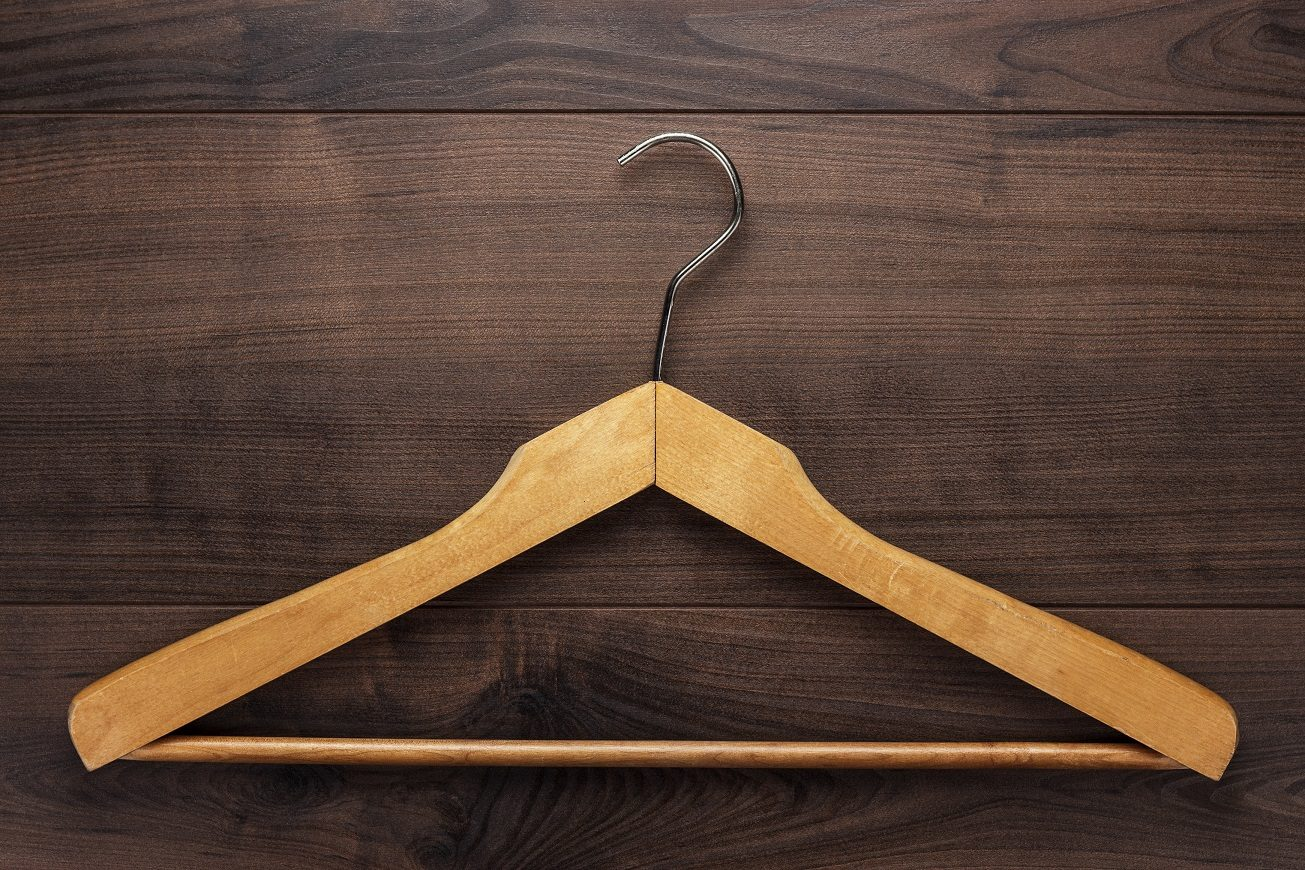 clothing-hanger-on-brown-table