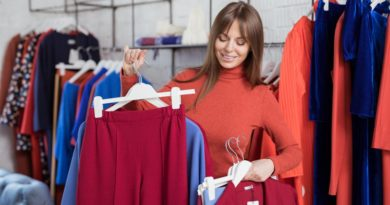 smiling-girl-with-hangers-indoors-ppwms7e-1000x667