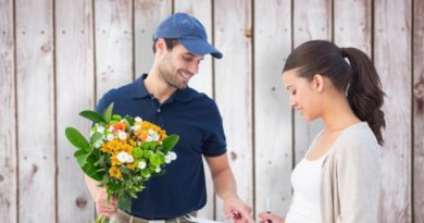 depositphotos_68913313-stock-photo-happy-flower-delivery-man-with