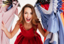 woman-shopper-peeking-out-through-clothing-in-clothes-rack