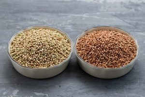 green-and-brown-buckwheat-in-bowl-on-ceramic-background-300x200-8647957
